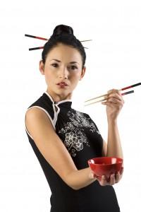 oriental girl with chopstick
